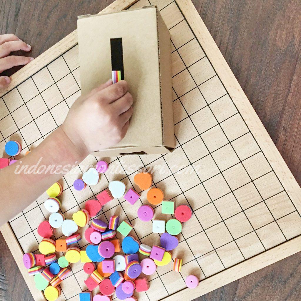 Kegiatan Montessori untuk Bayi Imbucare Box